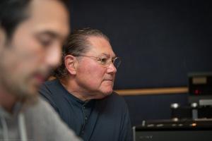 Sound engineer Jon Chi and studio owner Ken Krei listen to a track.