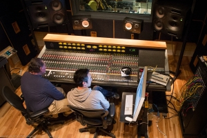 Studio owner Ken Krei and sound engineer Jon Chi at the Third Ward Records soundboard.
