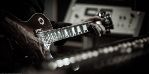 Tyler Famularo lays down a slide guitar track on his Gibson.