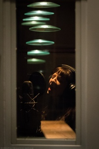 Rebecca laying down a vocal track.