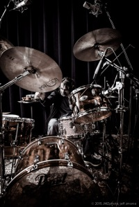 Jeff laying down the beat on his Pearl drum set.